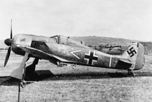 Focke-Wulf Fw 190A-3 of 11/JG 2 after landing in the UK by mistake in June 1942. Introduced in 1941 to supplement the ME 109, the FW 190 was probably Germany's best piston-engined fighter. MH 4190 Part of ROYAL AERONAUTICAL SOCIETY